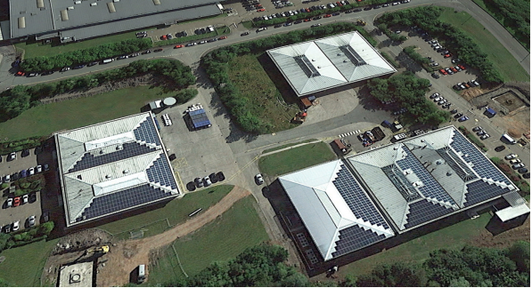 An aerial view of the Eurocaps factory, showing solar PV panels on 2 of their 3 buildings